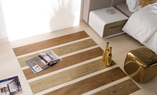 用木地板不合适,这个区域主要的材料只能选择瓷砖