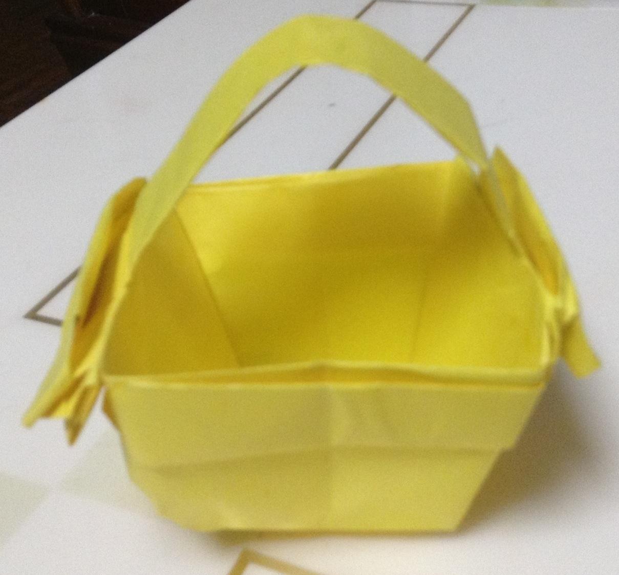 用彩纸折小猫的步骤